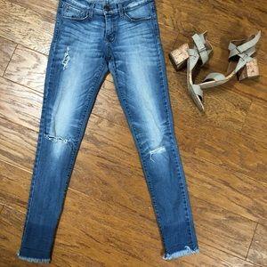 Distressed hem dark wash jeans